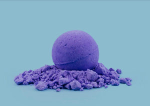 Purple CBD bath bomb on blue background